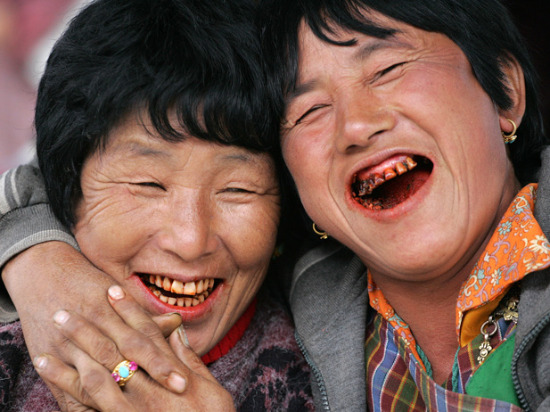 Women laugh at a vegetable market in Bhutanese capital Thimpu