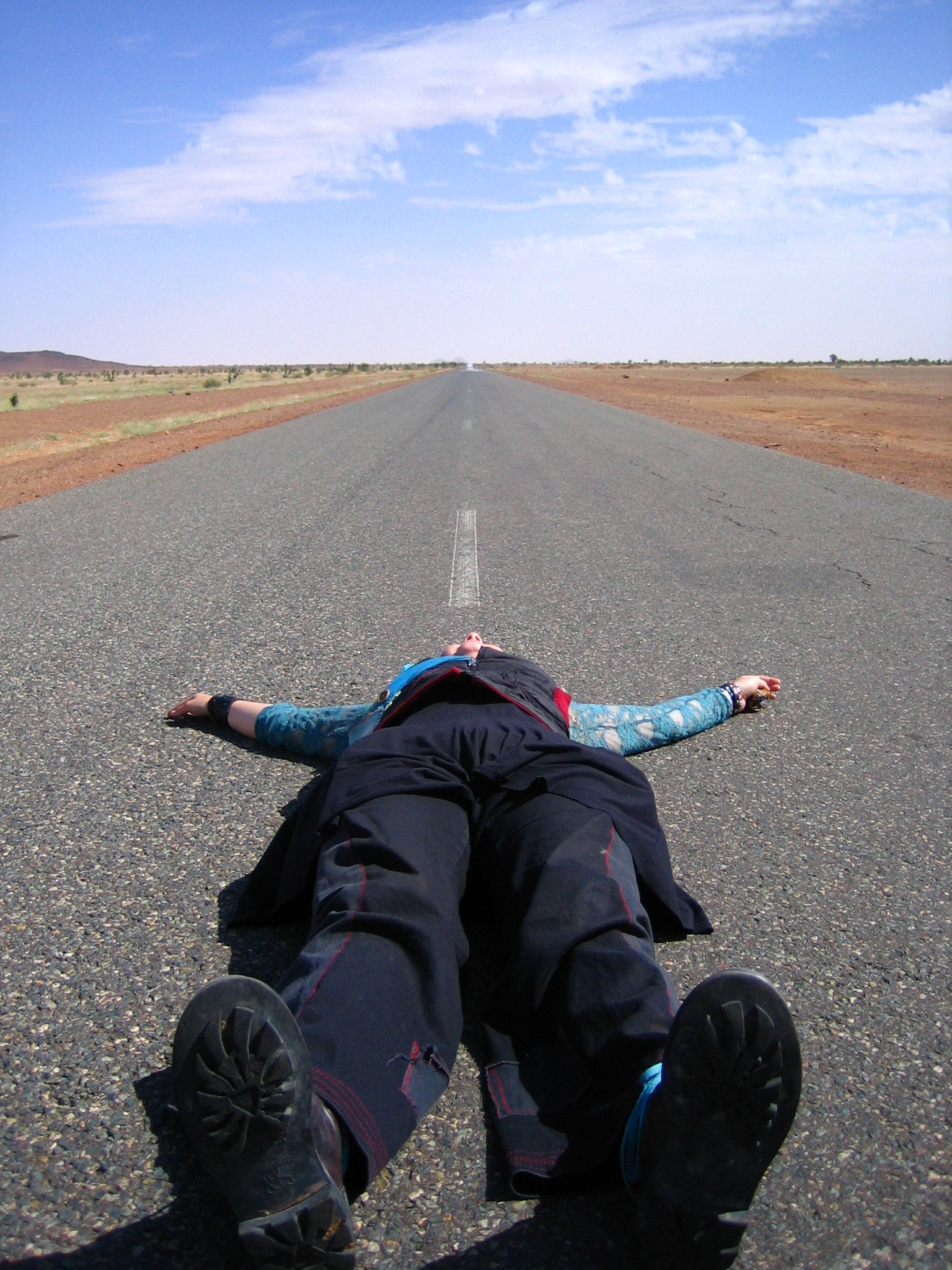 This picture is from hitchhiking in Mauritania a few years ago.  I love how it captures the sense of being overwhelmed and at peace at the same time, combined with being sort of stupid (i actually fell asleep in the middle of the road!) Infinite possibilities!